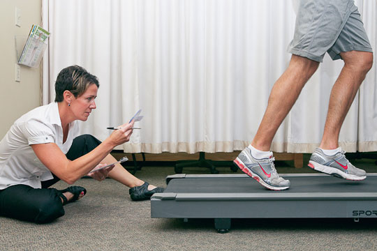 Customer receives gait analysis when shopping for running sneakers