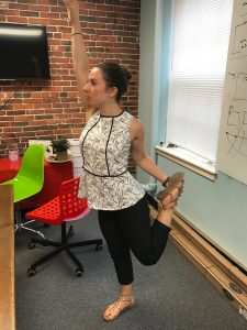 office yoga standing thigh stretch